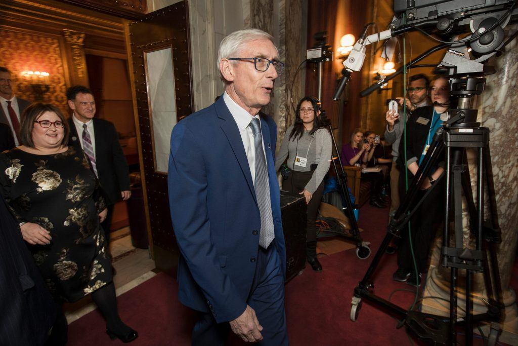 Evers says he's giving up on lockdown